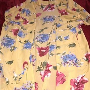Floral accessory top can be used as a cardigan.